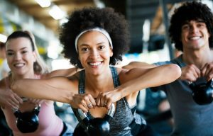 cheerful fit fitness lady with kettlebell