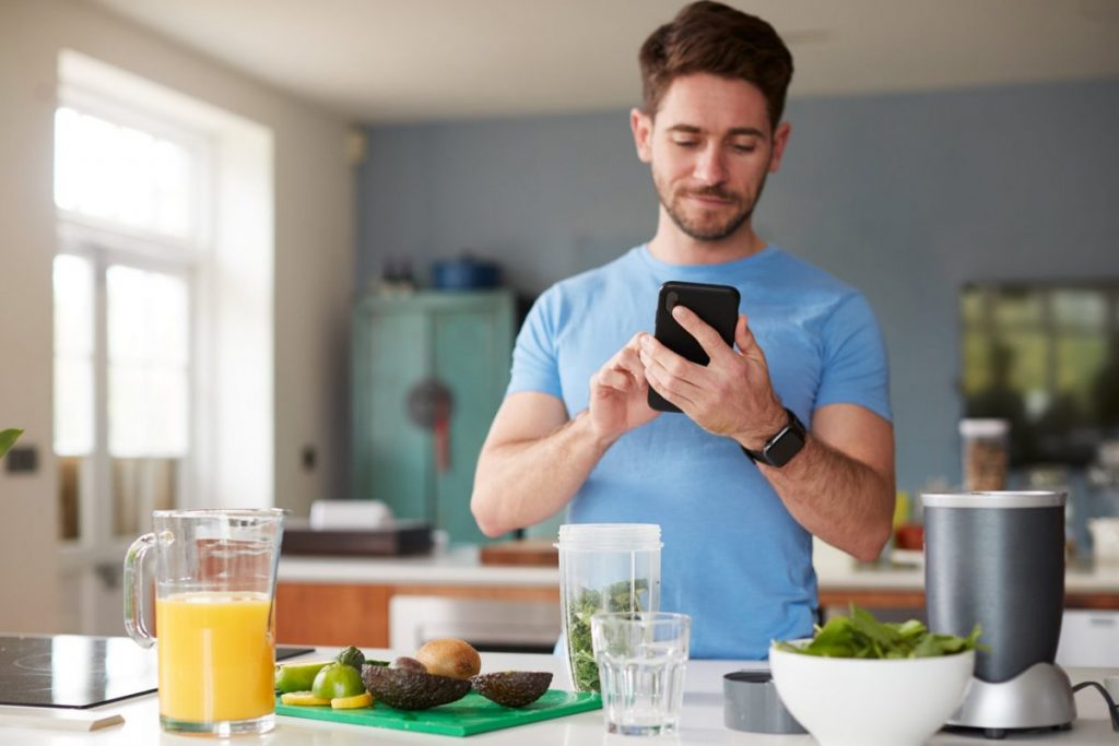 man using fitness tracker to track calories and macros