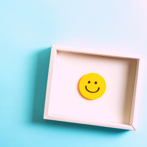 blue background with red frame including yellow happy face
